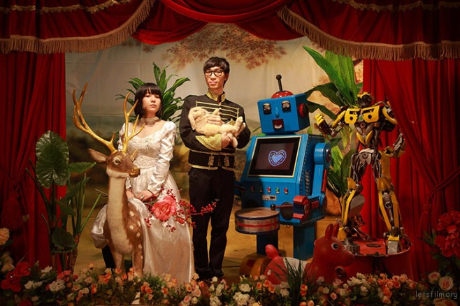 A couple posing with robots