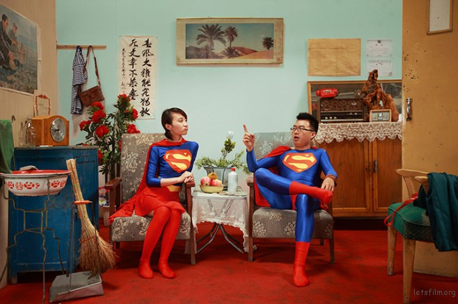 A couple wearing matching Superman outfits