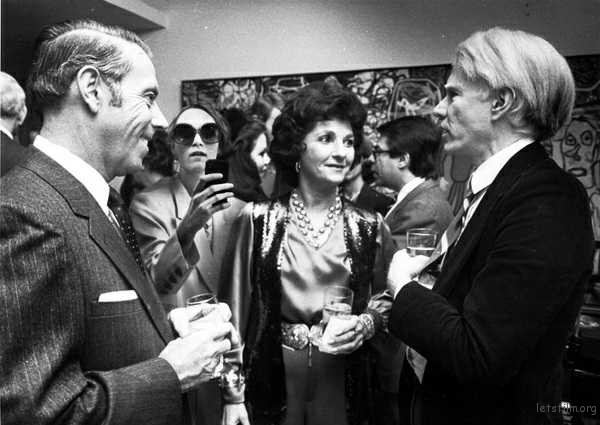 Shot November 28, 1979 / EVENT: Party for Andy Warhol at the home of Raymond and Patsy Nasher / shown here are Warhol (from left), Patsy Nasher and Dallas City Manager George Schrader