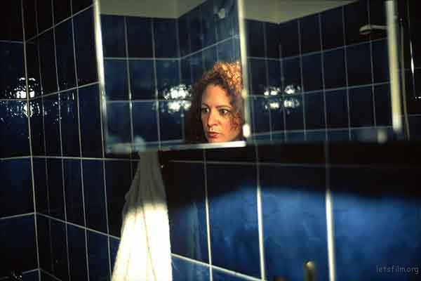 06-Nan-Goldin-Self-Portrait-in-my-Blue-Bathroom-Berlin-1991