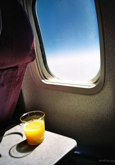 15年8月-飞机上-一杯汇源橙汁-@nieweiiewein