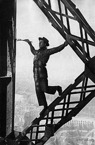 marc-riboud-eiffel-tower-painter-paris-france-1953