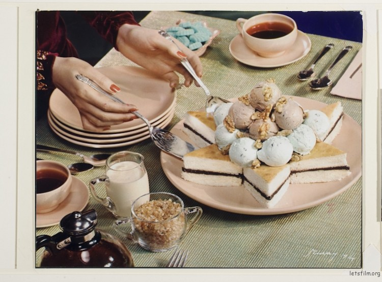 "Nickolas Muray, ""Table set for dessert, hands with silver utensils serving cake with ice cream"" (1944)"