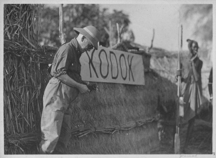 George Eastman beside Kodok sign, African Safari (1928)