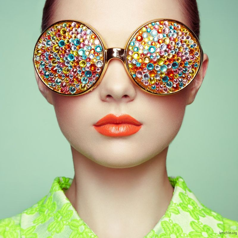 Portrait of beautiful young woman with colored glasses by Oleg Gekman on 500px.com